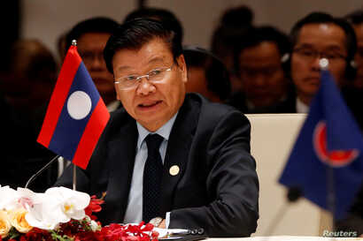 Laos' Prime Minister Thongloun Sisoulith speaks at the 10th Cambodia-Laos-Vietnam summit as part of the Greater Mekong Subregion Summit in Hanoi, Vietnam, March 31, 2018.