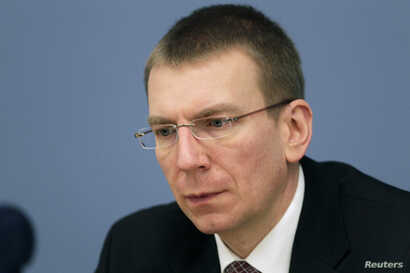 FILE - Latvia's Minister of Foreign Affairs Edgars Rinkevics attends a news conference in Riga, Jan. 25, 2012.