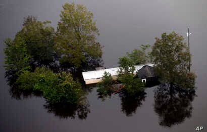Floodwaters surround a trailer in the aftermath of Hurricane Florence in Pollocksville, N.C., Sept. 17, 2018.