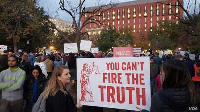 """Several hundred demonstrators gathered outside the White House and in Lafayette Park, just north of the White House, in Washington, Nov. 8, 2018. The protesters, some carrying signs of """"Trump is not above the law"""" and """"You can't fire the truth,"""" list..."""