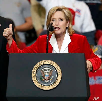 Appointed U.S. Sen. Cindy Hyde-Smith, R-Miss., with President Donald Trump, speaks during a rally, Nov. 26, 2018, in Biloxi, Miss.