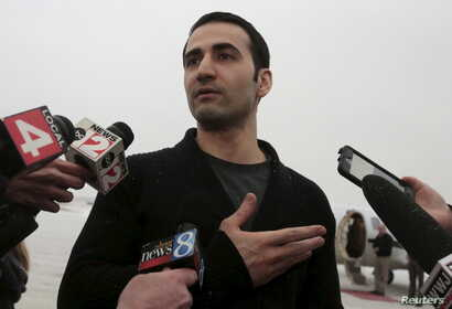 Former U.S. Marine Amir Hekmati, recently released from an Iranian prison, arrives at an airport in Flint, Michigan, Jan. 21, 2016.