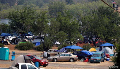 Evacuees from the Ranch Fire and River Fire (Mendocino Complex) are living in motor homes, cars and tents in the parking lot of the Moose Lodge in Clearlake Oaks, Calif., Aug. 2, 2018.