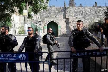 Israeli police forces stand guard the al-Aqsa mosque compound in the Jerusalem's Old City after it was closed off by Israeli authorities following clashes with Palestinian worshippers, July 27, 2018.