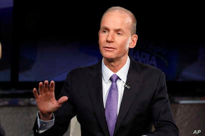 FILE - Boeing CEO Dennis Muilenburg is interviewed on the Fox Business Network, in New York, Nov. 13, 2018.