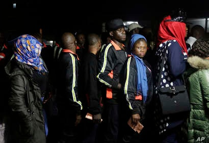 Nigerian returnees from Libya wait to be registered by officials upon arrival at the Murtala Muhammed International Airport in Lagos, Nigeria, Dec. 5, 2017.