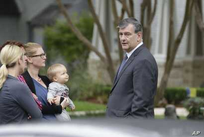 Dallas Mayor Mike Rawlings speaks to residents on the street of the apartment of a hospital worker in Dallas, Oct. 12, 2014.
