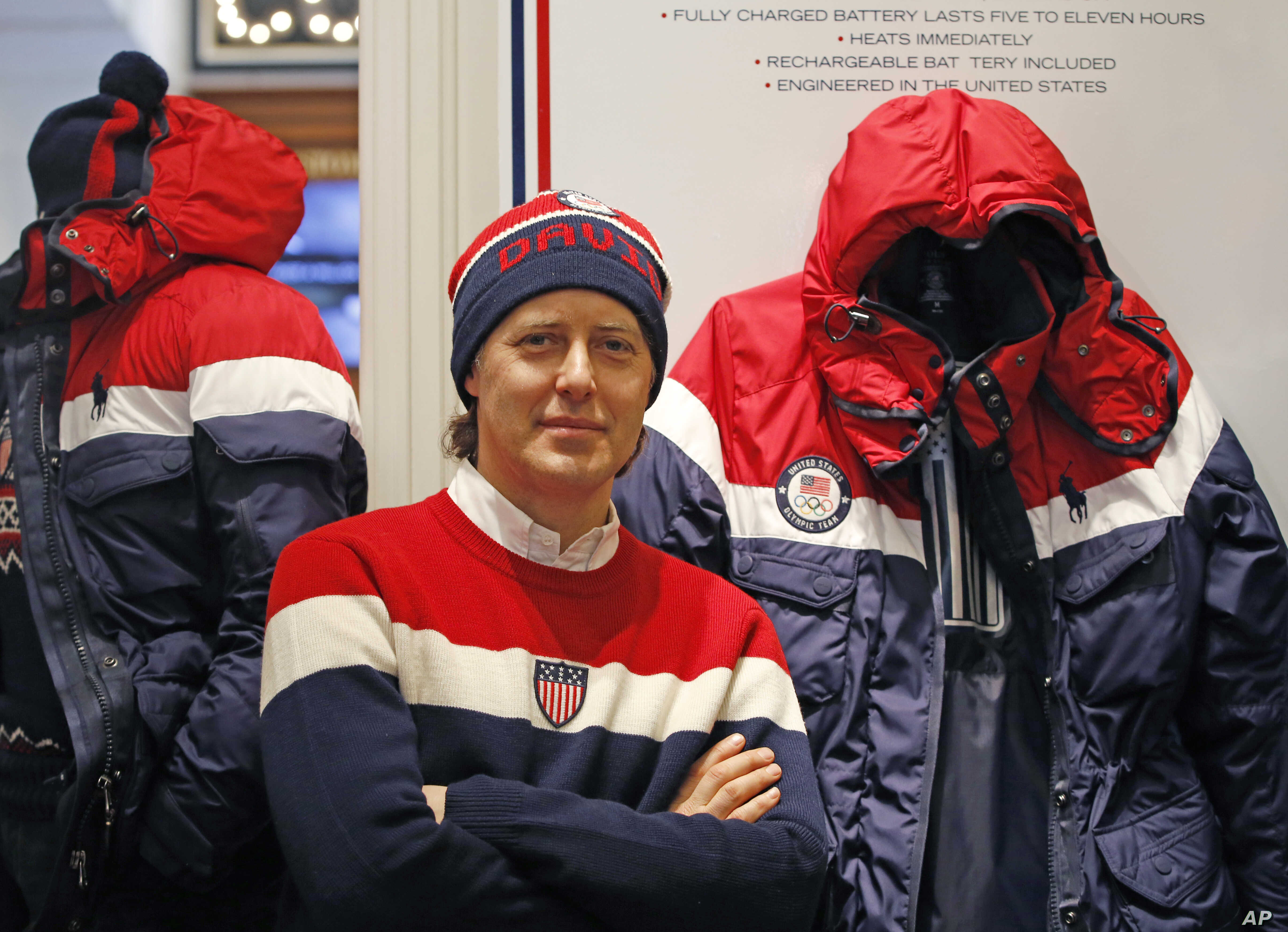 David Lauren poses beside Team USA's Opening Ceremony parka, which features a battery-powered heating element inside to keep athletes warm during the Winter Olympics in Pyeongchang, South Korea, Monday, Jan. 22, 2018, in New York.