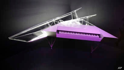 "An electric piano with a customized housing used by Lady Gaga is displayed at the exhibit ""Play It Loud: Instruments of Rock & Roll,"" at the Metropolitan Museum of Art in New York, April 1, 2019."