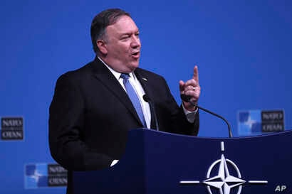 U.S. Secretary of State Mike Pompeo speaks during a media conference after a meeting of NATO foreign ministers at NATO headquarters in Brussels, Tuesday, Dec. 4, 2018.