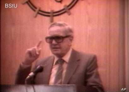 In this image taken from video, notorious British spy Kim Philby is shown telling members of East Germany's intelligence service that stealing top-level secrets and betraying your country is as simple as having a few drinks with the right person. The...