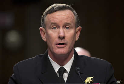 """FILE - Navy Adm. William McRaven, commander, U.S. Special Operations Command, testifies on Capitol Hill in Washington, March 5, 2013. McRaven has written an open letter to President Donald Trump saying revoking his security clearance would be an """"hon"""