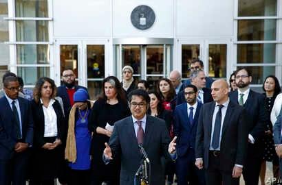 FILE - Omar Jadwat, center, director of the ACLU's Immigrants' Rights Project, speaks at a news conference outside a federal courthouse in Greenbelt, Md.