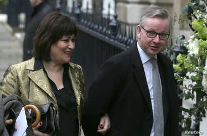 FILE - Michael Gove and wife Sarah Vine arrive for a reception to celebrate the wedding between media mogul Rupert Murdoch and former supermodel Jerry Hall, in London, March 5, 2016.
