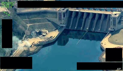 This photo released on March 27, 2017 by the official Twitter account of Operation Inherent Resolve, shows the Tabqa Dam, in Raqqa, Syria.