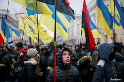 People attend a rally calling for Ukrainian lawmakers to recognize Russia as an aggressor state and support other anti-Russian legislative changes, near the Parliament building in Kyiv, Ukraine, Jan. 16, 2018.