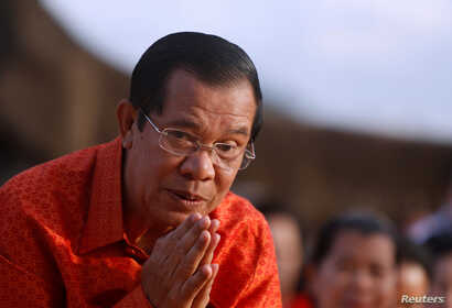 Cambodia's Prime Minister Hun Sen attends a ceremony at the Angkor Wat temple to pray for peace and stability in Cambodia, Dec. 3, 2017.