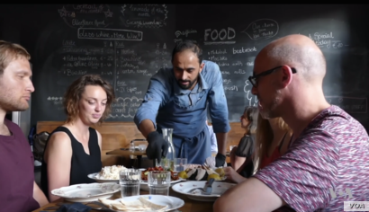Syrian cook Abdell Baset introduces new foods to restaurant patrons.