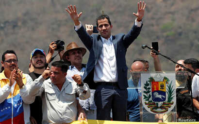FILE PHOTO: Venezuelan opposition leader Juan Guaido, who many nations have recognized as the country's rightful interim ruler, takes part in a rally against President Nicolas Maduro's government in Valencia, Venezuela, March 16, 2019.