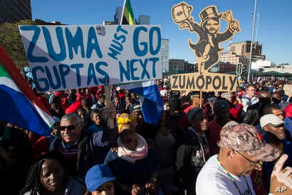 Protesters call for the removal of president Jacob Zuma in a march on Parliament in Cape Town, South Africa, Monday, Aug. 7, 2017.  South Africa's parliament will vote by secret ballot on a motion of no confidence on South African President Jacob Zum...