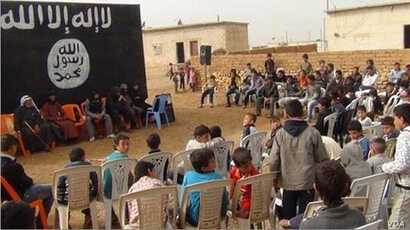 A year-end ceremony for school children at an Islamic State-run school.
