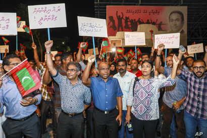 Maldivian opposition supporters shout slogans during a protest as they the urge the government to obey a Supreme Court order to release and retry political prisoners, in Male, Maldives, Feb. 4, 2018.