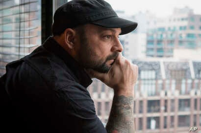 Christian Picciolini, founder of the group Life After Hate, poses for a photograph in his Chicago home, Jan. 9, 2017. Picciolini, a former skinhead, is an activist combatting what many see as a surge in white nationalism across the United States. He'