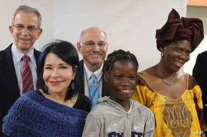 Janet Sylva (second from right) and her mother, Philomena (right) meet with surgeons and others at Cohen Children's Medical Center in New Hyde Park, N.Y., March 9, 2017. Her surgeons are Dr. David Hoffman (left), director of the division of Oral and...