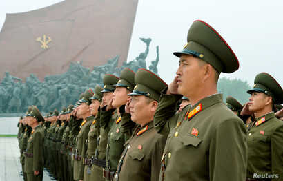 North Korean soldiers salute at Mansudae hill in Pyongyang, North Korea, in this photo taken by Kyodo, Sept. 9, 2017, on the 69th founding anniversary of the country.