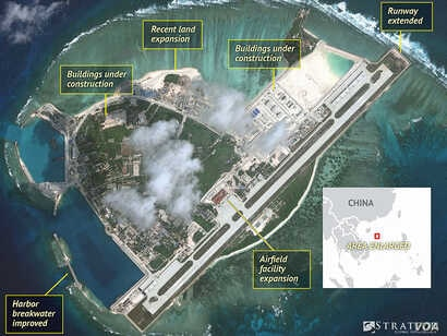 Satellite imagery analysis by geopolitical intelligence firm Stratfor shows overall land, building and military expansion by China on Woody Island in the South China Sea. (Courtesy of Stratfor)
