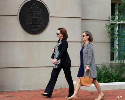 Kathleen Manafort, left, walks to the Alexandria Federal Courthouse in Alexandria, Va., Aug. 2, 2018, to attend the tax evasion and bank fraud trial of her husband, Paul Manafort.