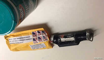 """A package containing a """"live explosive device"""" according to police, received at the Time Warner Center which houses the CNN New York bureau, in New York City, is shown in this handout picture provided Oct.24, 2018."""