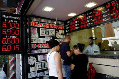 People change money at a currency exchange office in Istanbul, Turkey, Aug. 10, 2018.