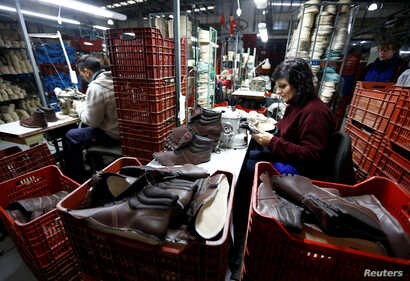 Workers manufacture security footwear at the Boris factory plant in Quilmes, Argentina, May 19, 2016.