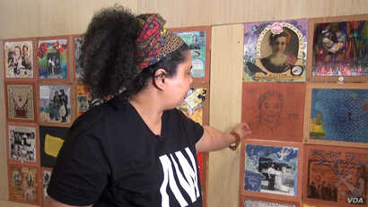 Artist Shante Bullock is descended from slaves and cannot trace them back more than a few generations. She says even though her ancestors did not come voluntarily, she shares the hope of others whose ancestors came to the U.S. (Jsoh/VOA)