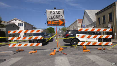 There are road blocks throughout downtown Austin, Texas, during the South by Southwest festival so pedestrians can freely and safely move from venue to venue protected from traffic.