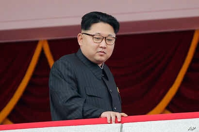 FILE - North Korea's leader Kim Jong Un watches a parade in Pyongyang, May 10, 2016. The U.S. imposed sanctions Wednesday, July 6, 2016, on North Korean leader Kim Jong Un and 10 other top officials for human rights abuses in an escalation of Washing...