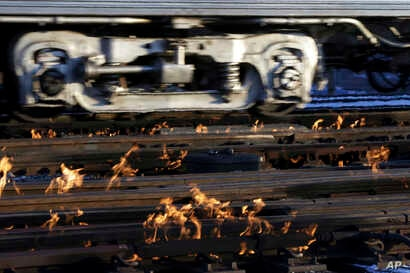 A Metra train moves southbound to downtown Chicago as the gas-fired switch heater on the rails keeps the ice and snow off the switches near Metra Western Avenue station in Chicago, Jan. 29, 2019.