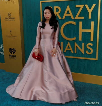 """Cast member Awkwafina poses at the premiere for """"Crazy Rich Asians"""" in Los Angeles, California, U.S., August 7, 2018."""