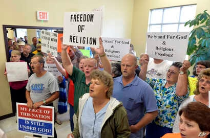 Rowan County Clerk Kim Davis' supporters file into the courthouse in Morehead, Ky., Sept. 1, 2015. Davis refused to issue marriage licenses, defying a federal order.
