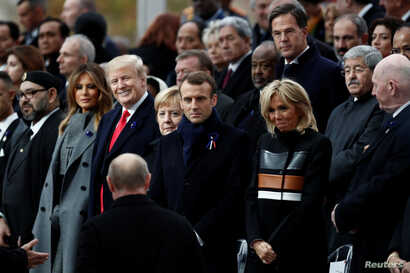 Russian President Vladimir Putin arrives to take his place with French President Emmanuel Macron, Brigitte Macron, German Chancellor Angela Merkel, U.S. President Donald Trump and first lady Melania Trump to attend a commemoration ceremony for Armist...