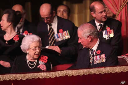 Queen Elizabeth II (left-front) and Prince Charles (right-front), and others attend the Royal British Legion Festival of Remembrance at the Royal Albert Hall in London, Nov. 10, 2018.