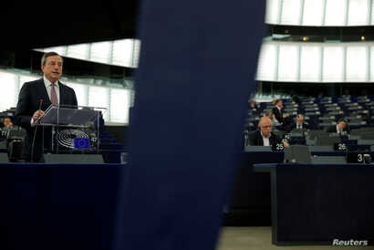 European Central Bank (ECB) President Mario Draghi delivers a speech during a debate on the ECB annual report for 2016 at the European Parliament in Strasbourg, France, Feb. 5, 2018.