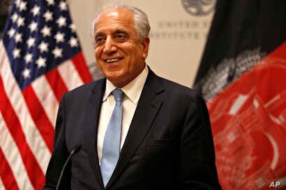 Special Representative for Afghanistan Reconciliation Zalmay Khalilzad approaches the microphone to speak on the prospects for peace, Feb. 8, 2019, at the U.S. Institute of Peace, in Washington.