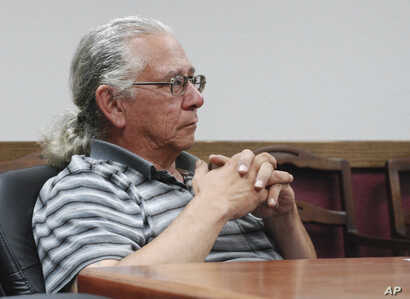 FILE - In this July 31, 2013 photo, O.J. Semans, of Rosebud, S.D., executive director of the voting advocacy group Four Directions, listens in Pierre, S.D., as the South Dakota Election Board discusses a proposal to use federal money to set up satell...