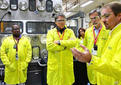 U.S Secretary of Energy Rick Perry, second from left, accompanied by Laboratory Director Charlie McMillan, second from right, learns about capabilities at the Los Alamos National Laboratory's Plutonium Facility, from Jeff Yarbrough, right, Los Alamos...