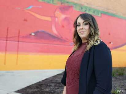 Brandy Corwin, 28, was laid off from General Motors twice before making the switch to become a call center employee at Credit Adjustments, Inc., a decision she says has afforded her stability as a mother of two.