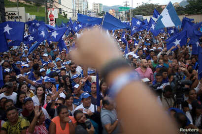 Supporters of President and National Party presidential candidate Juan Orlando Hernandez celebrate as they wait for official presidential election results in Tegucigalpa, Honduras, Nov. 28, 2017.