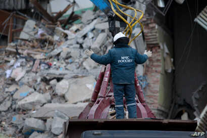 An emergency worker takes part in a search operation two days after a gas explosion rocked a residential building in Magnitogorsk, Russia, Jan. 2, 2019.