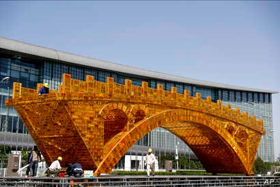 Workers install wires on a Golden Bridge of Silk Road structure on a platform outside the National Convention Center, the venue which will hold the Belt and Road Forum for International Cooperation, in Beijing, April 18, 2017.